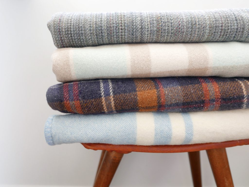 stack of woollen fabrics for up cycle sewing